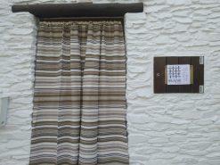cortina de tejido Alpujarreño beis con marrones