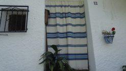 Cortina Alpujarreña beis con azul para puertas y ventanas