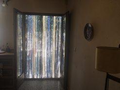 cortina de tiras de jarapa en azul